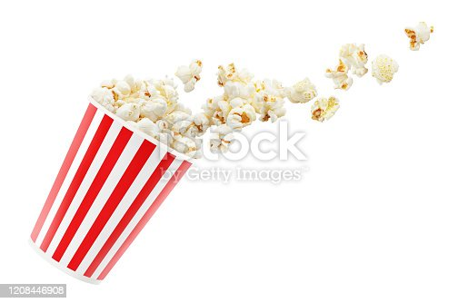Delicious popcorn falling out of red striped paper cup, isolated on white background