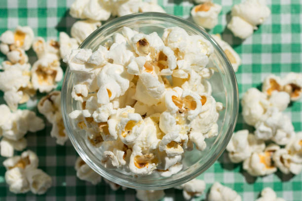 Popcorn. Food of Festa Junina, a typical brazilian party. Snack on green plaid table. stock photo