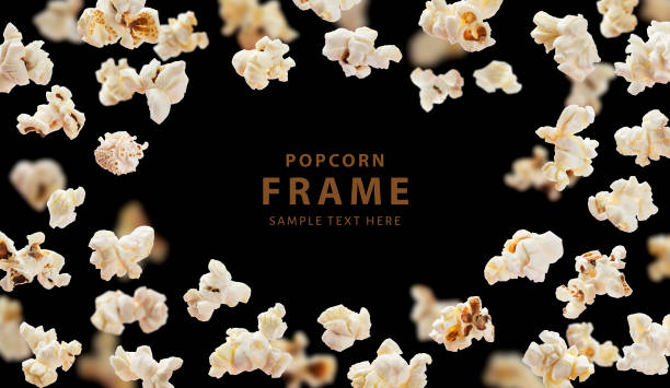 Popcorn frame, flying popcorn isolated on black background with copy space, movie poster concept stock photo