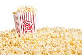 Movie Popcorn container and pile of popcornRelated Images: