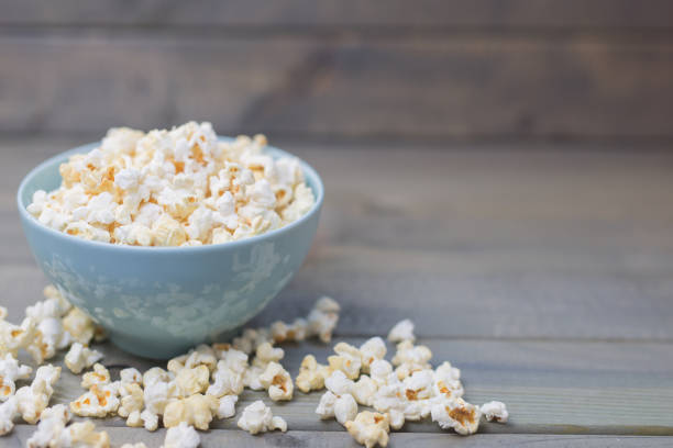 Popcorn in a pastel blue bowl stock photo