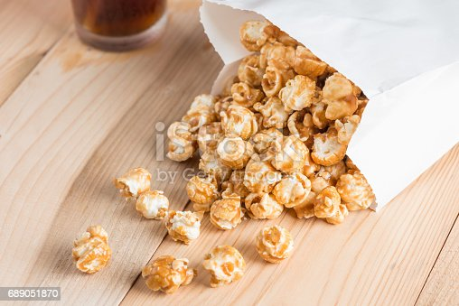 Popcorn in bag on table.