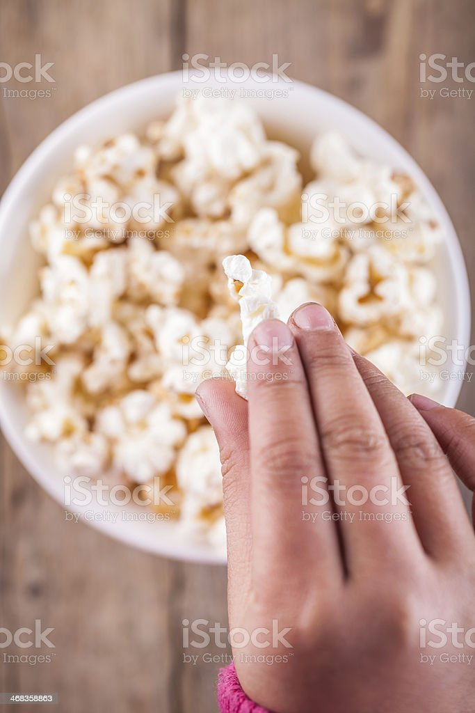 popcorn in kid hand royalty-free stock photo