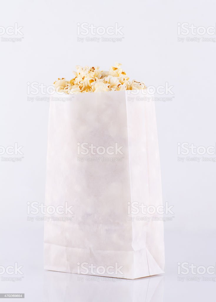 Popcorn in paper bag isolated on white background stock photo