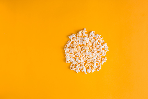 istock Popcorn in the shape of record button on yellow background. Flat lay banner, top view. Cinema, movies and entertainment concept. 1222206272
