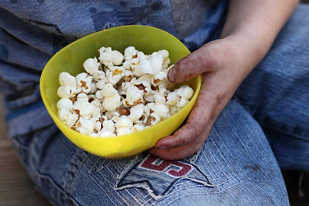 Popcorn in yellow bowl as snack stock photo