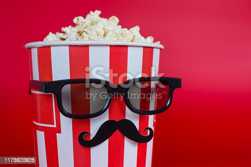 istock Pop-corn is not for trailers! Cropped closeup photo of cool comic joking with serious facial expression handsome with xmas mood bag with tasty yummy delicious food isolated vivid background 1173620925