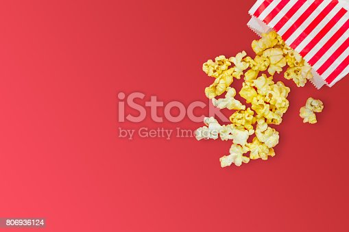 istock Popcorn on red background 806936124