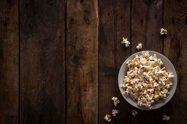 Popcorn on Rustic Wooden Background – Foto