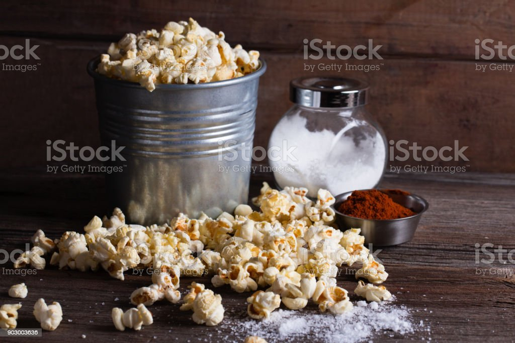 Popcorn on wooden table, close up stock photo