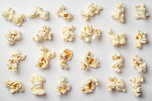 istock Popcorn pattern on white background. Top view 1064692782