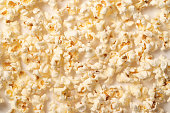 istock Popcorn pattern on white background. Top view 1065101272