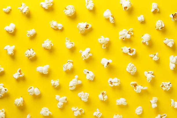 Popcorn pattern on yellow background. Top view stock photo