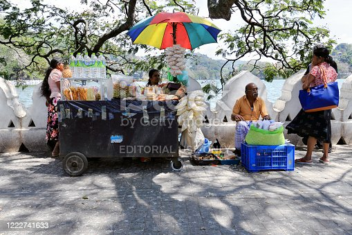 Kandy, Sri Lanka - February 11, 2020: Street vendors sell popcorn, fruit and water in downtown Kandy