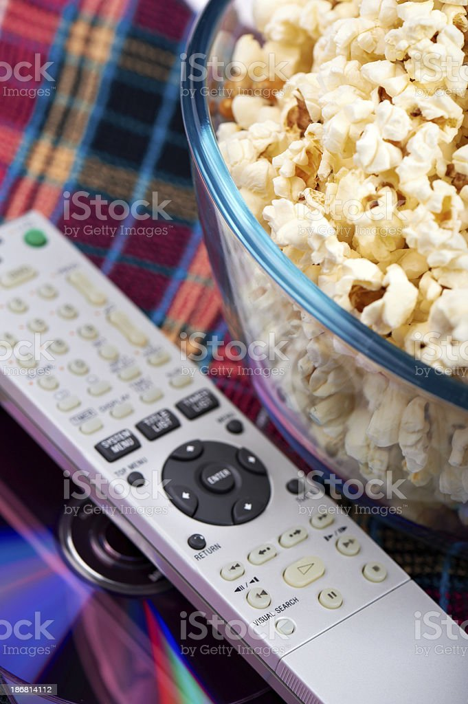 Popcorn, Remote and DVD stock photo