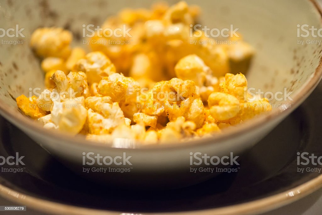 Popcorn Seasoned with Asian Spices in Earthenware Bowl stock photo