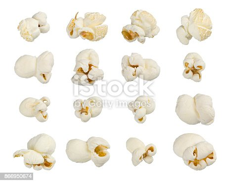 Scattered popcorn isolated on white background. Close up shot. High quality image. astfood popular during a movie in a cinema. Desogn element for advertisement, flyer, poster.