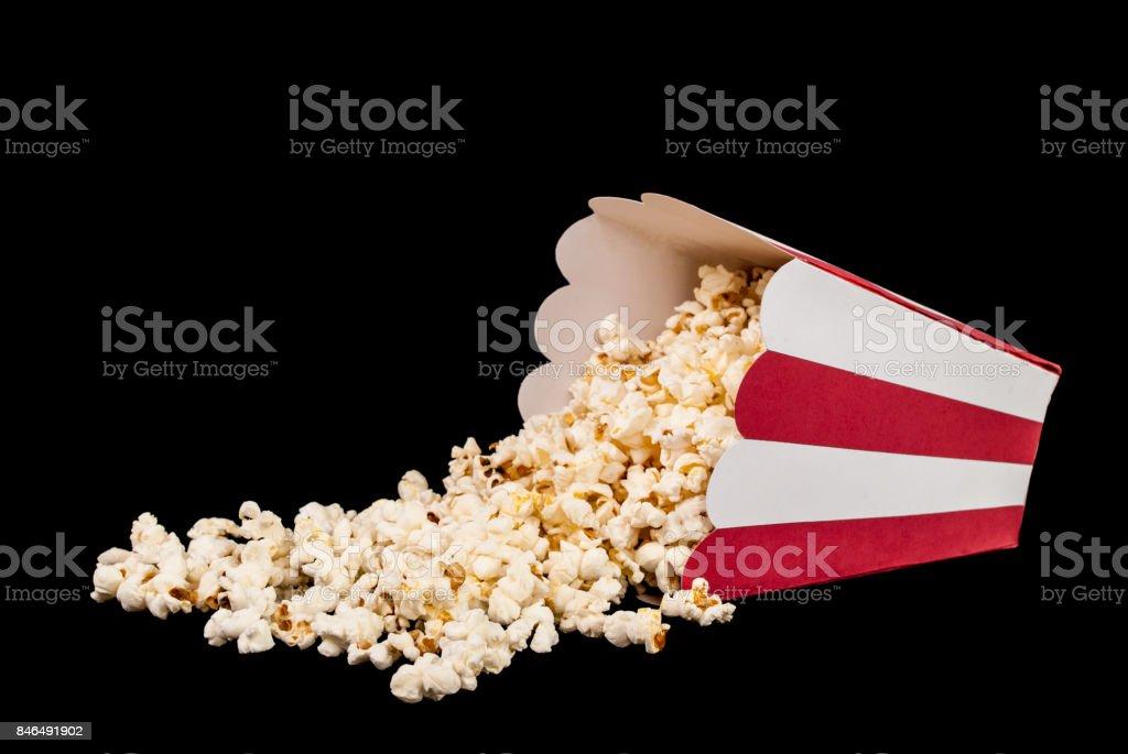 Popcorn spilled on black background stock photo