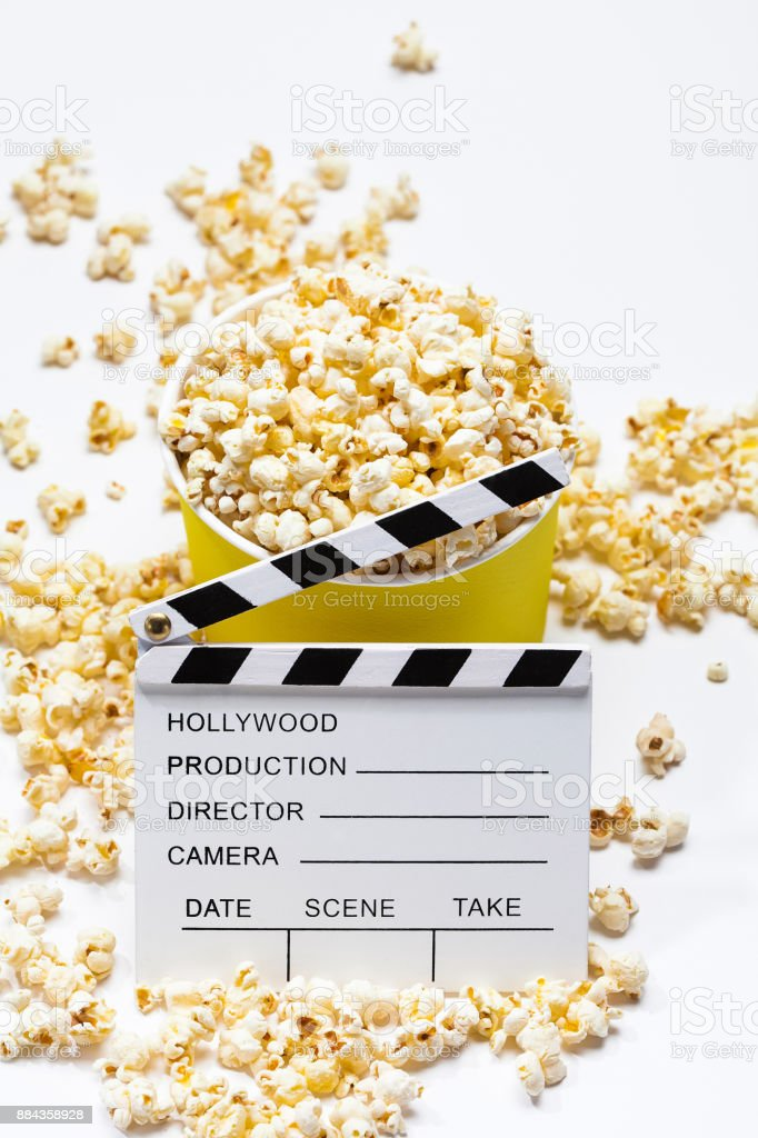 Popcorn with clapperboard on a white stock photo