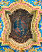 Pope Pius IX coat of arms in the ceiling of the Basilica of Sant'Anastasia near the Palatine in Rome, Italy. March-23-2019