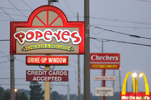 Popeyes checkers and mcdonalds signs at sunrise