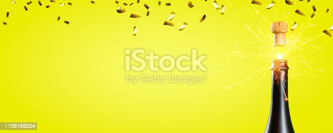 1051699126 istock photo popgun and raining gold confetti on yellow background 1159186004
