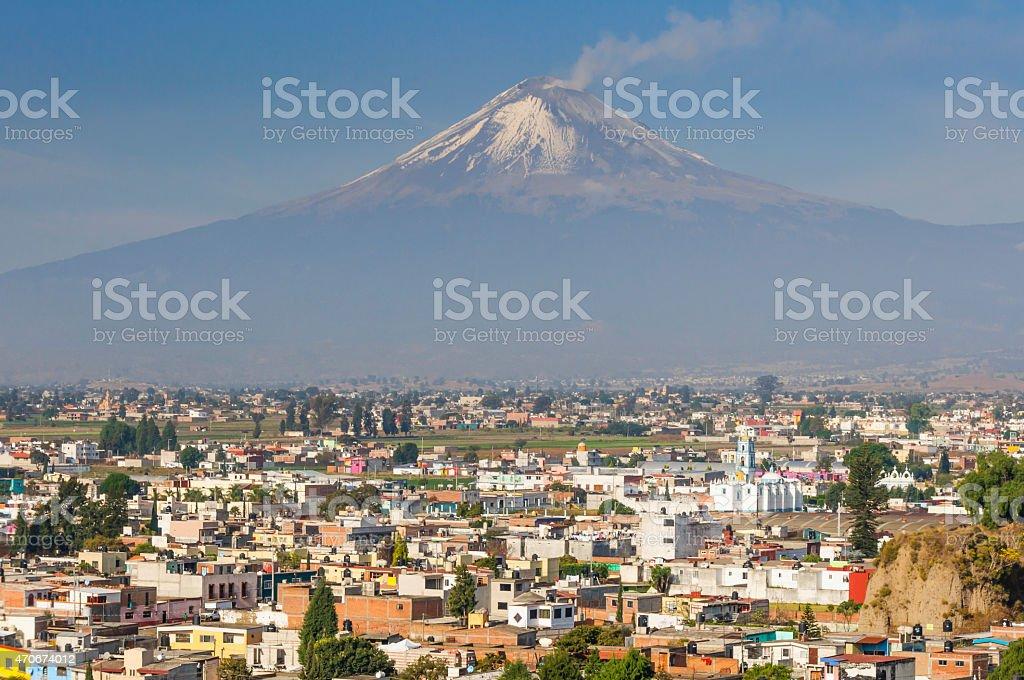 Popocatepetl volcano seen from Cholula (Mexico) stock photo