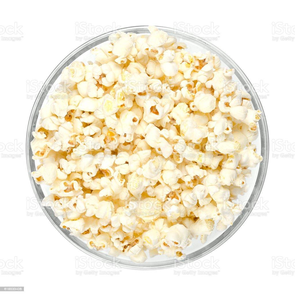 Popped popcorn in glass bowl over white stock photo