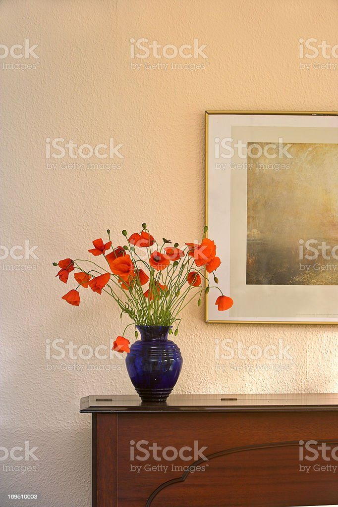 Poppies brightening up a home  stock photo