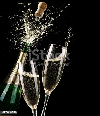 istock Popping Champagne And Toast Of Midnight 497640298