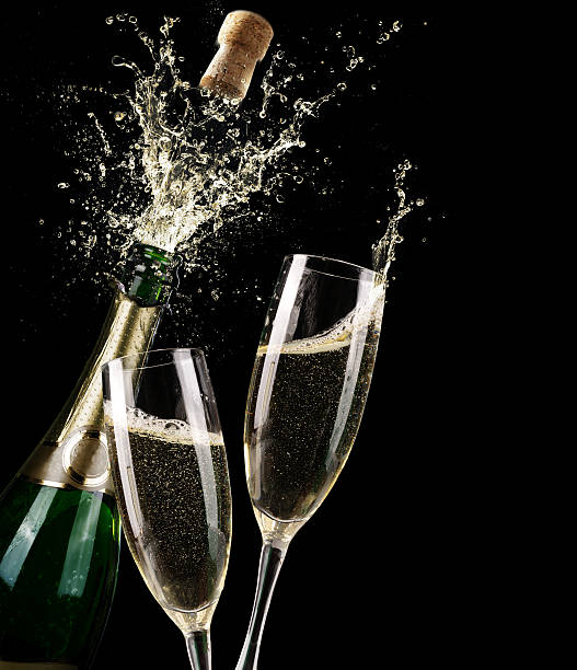 popping champagne and toast of midnight - champagne stock pictures, royalty-free photos & images
