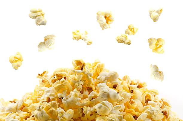 Popping popcorn stock photo