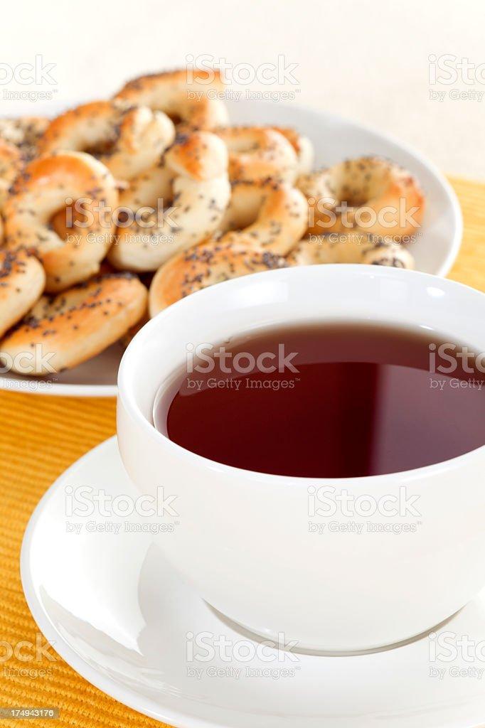 Poppy pretzels with tea royalty-free stock photo