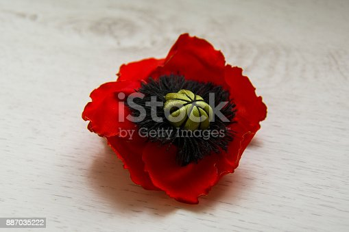 poppy seed made of fabric in the form of a flower, on the table