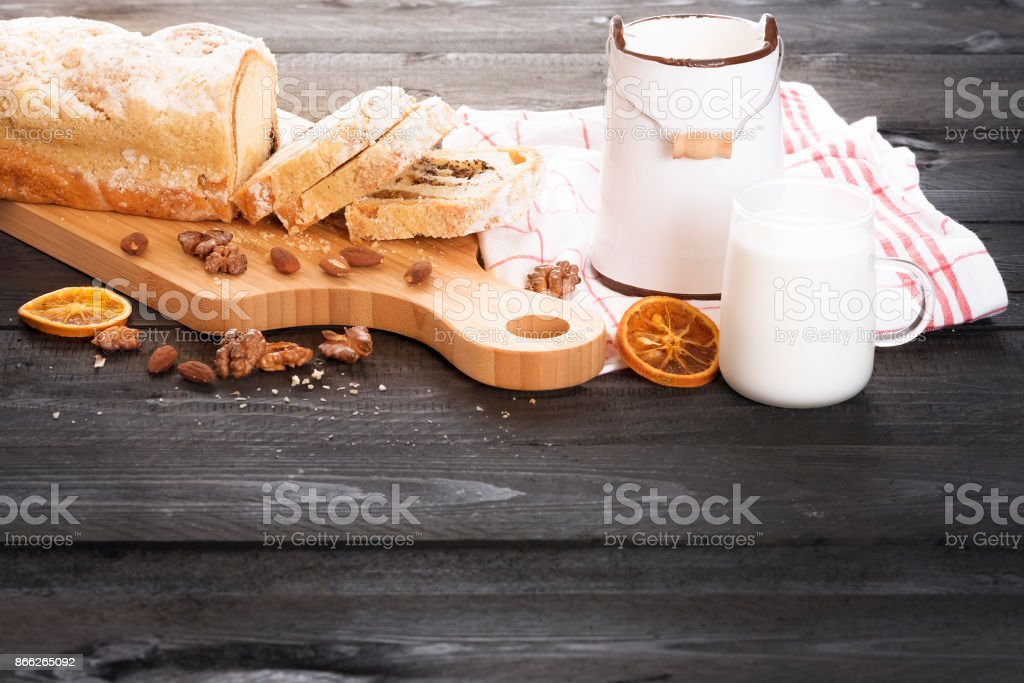 Poppy seed pound cake and cup of milk stock photo
