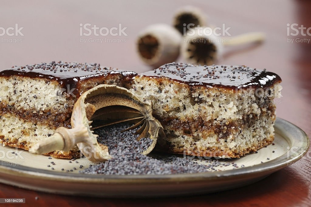 Poppy seed sponge cake with plum jam royalty-free stock photo