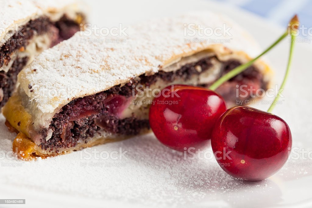 Poppy seed strudel with cherry. royalty-free stock photo