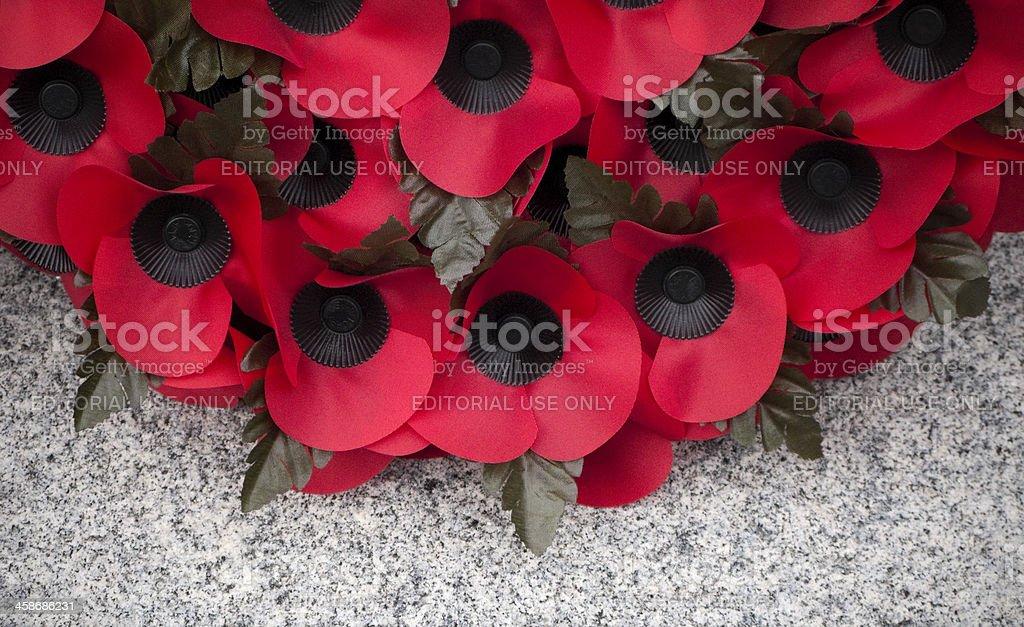 Poppy wreath on a stone war memorial royalty-free stock photo