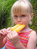 Four-year-old girl enjoying a refreshing popsicle