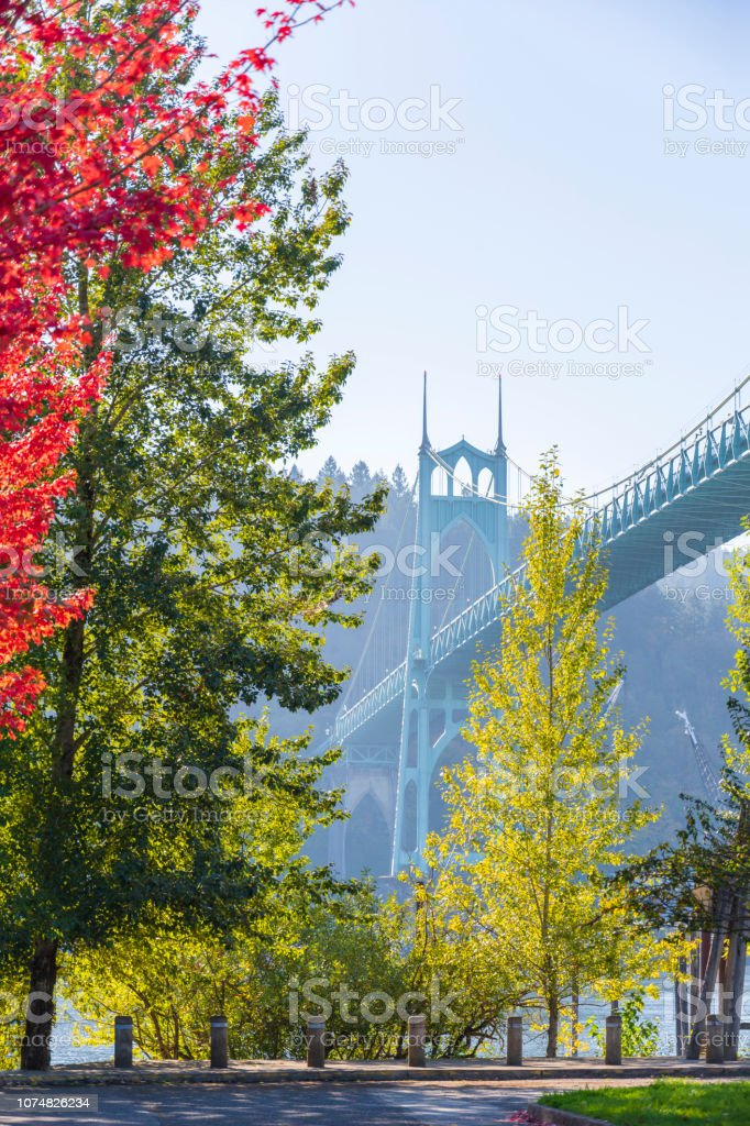 Popular gothic arched St Johns bridge in portland surrounded by autumnal trees stock photo