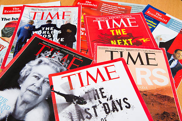 Popular Magazines Shanghai, China - Oct 2, 2013: Popular Magazines in English language displayed, including Time and The Economist. Magazines are a great way to learn news, culture and short stories. They generate the majority of their income through advertising. time magazine stock pictures, royalty-free photos & images
