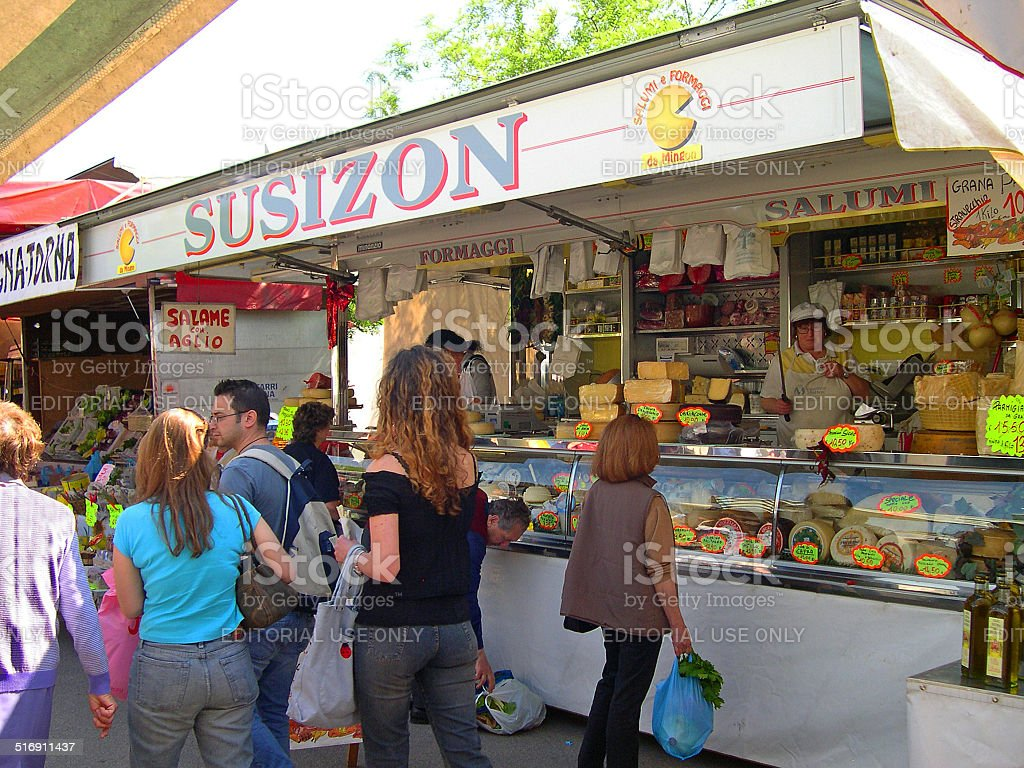 Tourists and locals at a cheese stand during the Wednesday outdoor...
