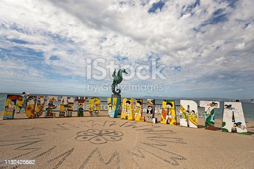 Puerto Vallarta, Mexico - February 2019: Life-sized letters spell out Puerto Vallarta and people always stop by for a selfie.