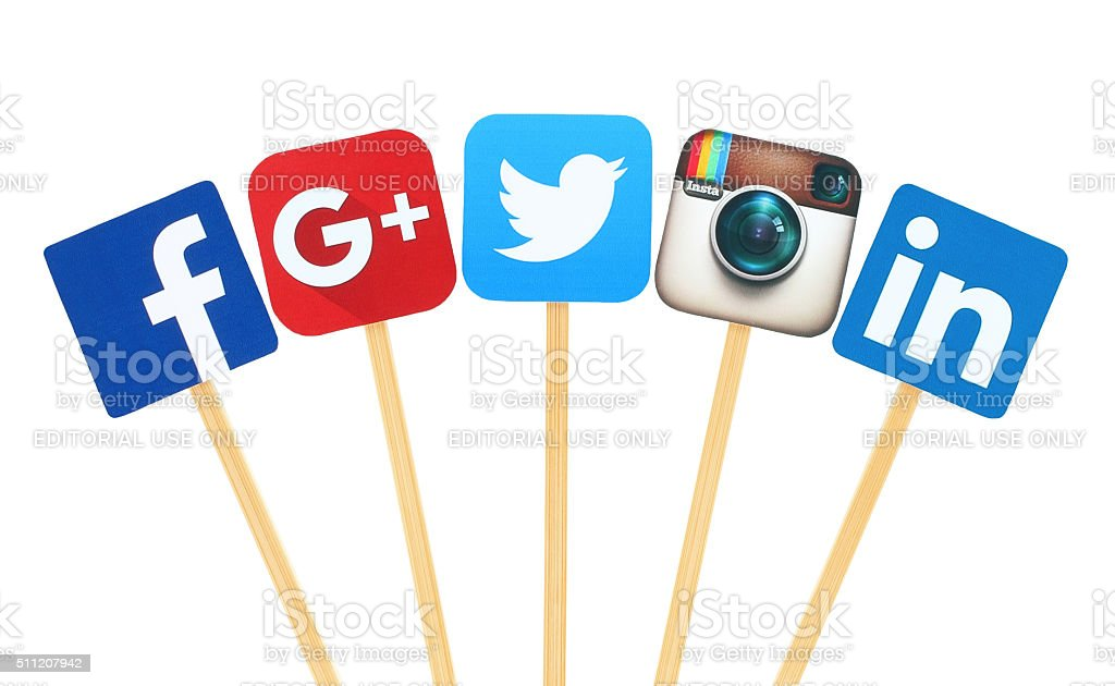 Popular social media logo signs printed on paper, wooden stick stock photo