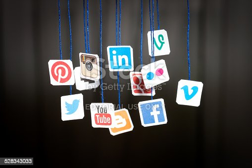 istock Popular social media website logos printed on paper and hanging 528343033