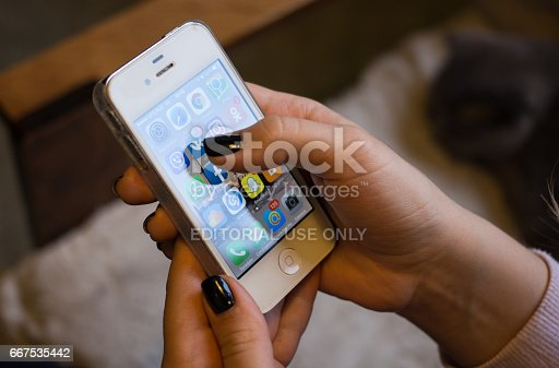 Moscow, Russia - April 8, 2017: A set of applications from famous brands of social networks on the iPhone in teenager hands. iPhone 7 Jet Black was created and developed by the Apple inc.