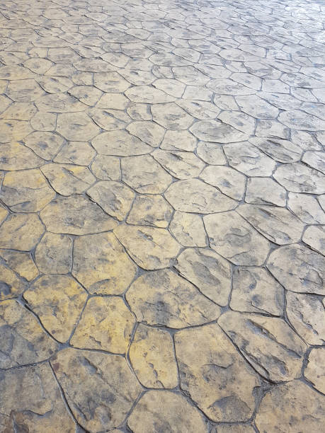 popular stamped concrete flooring - retro style stained grunge pedestrian walkway. - stamper stock photos and pictures