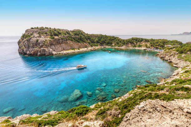 Popular tourist attraction on Rhodes island - azure lagoon known as Anthony Quinn Bay. Sea travel and summer paradise concept stock photo