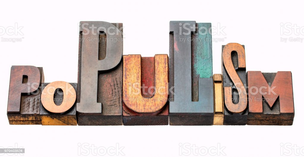populism word abstract in wood type stock photo