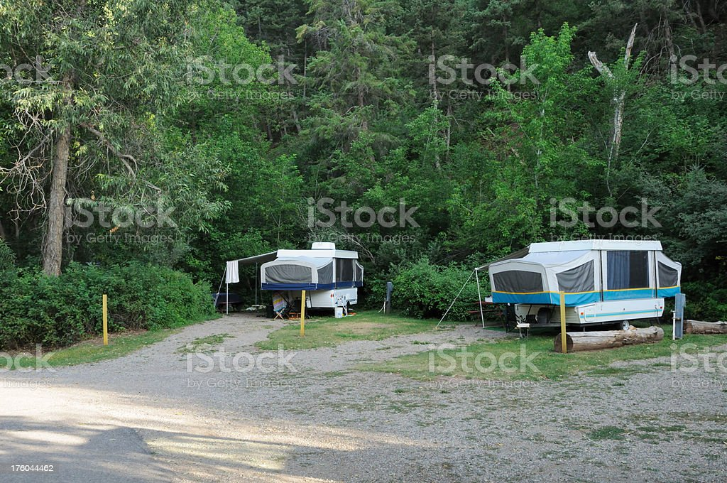 Popup campers in campground stock photo